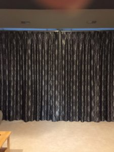 Draperies with room darkening lining. I deal for bedrooms and media rooms.