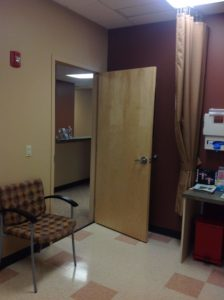 Exam room with a curtain for patients comfort. Fabrics are coordinated and with fire retardant quality.