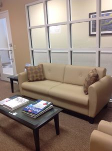 Waiting room, with comfortable sofa. Pillows where added for back support