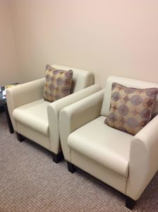 Comfortable chairs with pillows for back support.