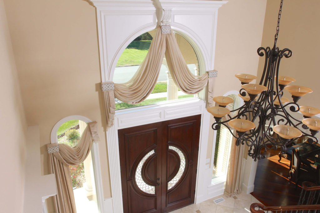Draperies for an arched window